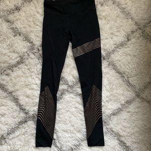 UA gold stripe tights